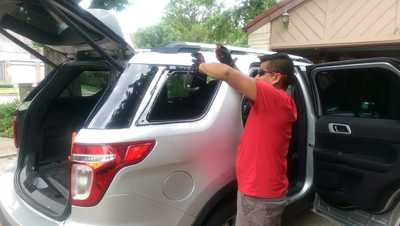 Auto Glass Repair on White SUV in Houston, TX